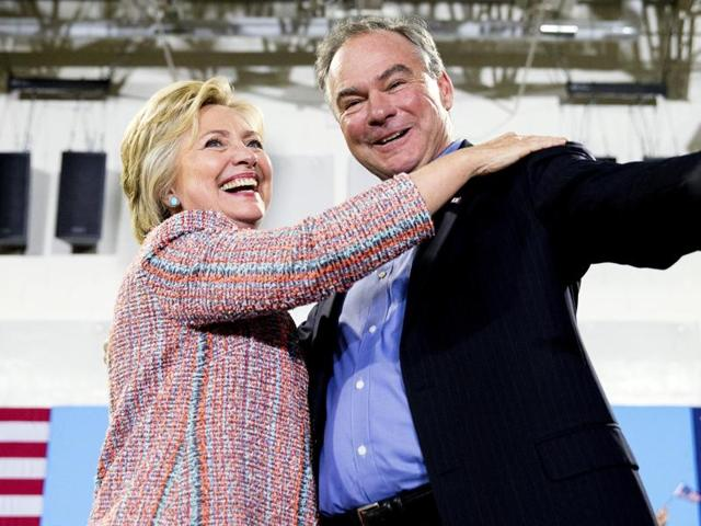 In this file photo, Democratic presidential candidate Hillary Clinton, accompanied by senator Tim Kaine, speaks at a rally.