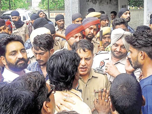Area residents at the crime spot in Shaheed Bhagat Singh Nagar in Ludhiana on Friday.