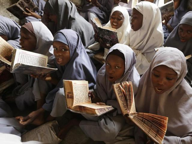 Muslim girls attend school in Kano, Nigeria. An appeals court ruled that Nigerian girls have the right to wear the hijab headscarf to school. Suicide bombers have abused Islamic dress to hide their deadly weapons.