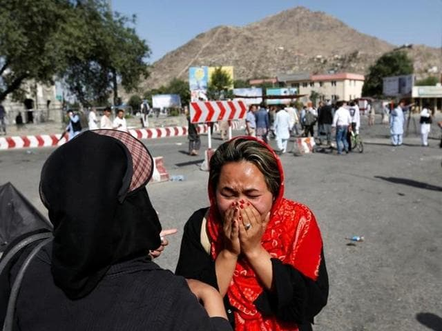 An Afghan woman weeps at the site of a suicide attack in Kabul.
