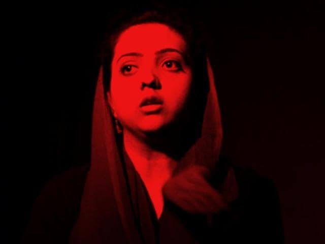 Theatre director Tushar Dalvi's play, The Darkroom Project, takes place in partial darkness. A red light is focuses on the actors.