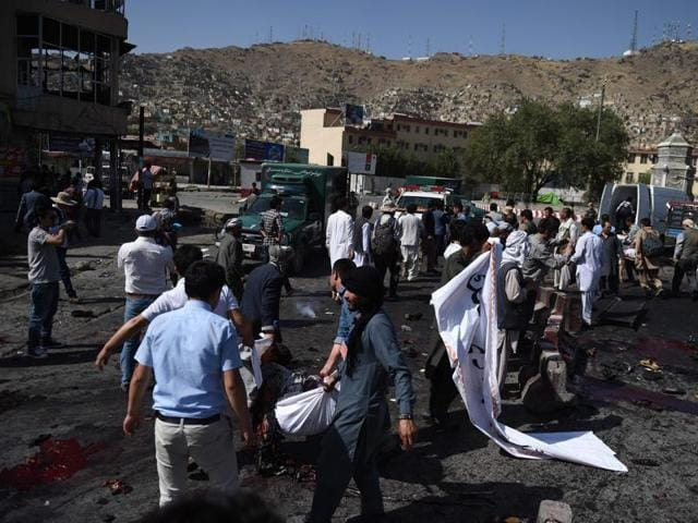 An Afghan protester screams near the scene of a suicide attack that targeted crowds of minority Shiite Hazaras during a demonstration at the Deh Mazang Circle in Kabul.