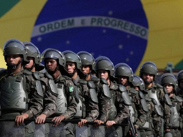 Brazilian army soldiers take part in a military exercise during presentation of the security forces for the Rio 2016 Olympic Games, in front of the National Stadium, in Brasilia.