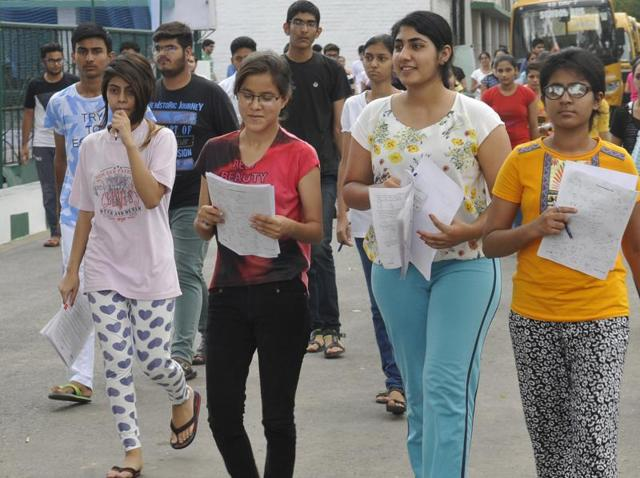 Students coming out from their centre after appearing in the NEET-2 exam at KBDAV Sector 7, Chandigarh on Sunday.
