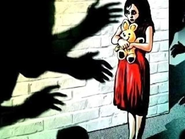 A sub-inspector posted with the Haryana Police was taken into custody after he allegedly tried to molest a six-year-old girl while travelling in a bus.