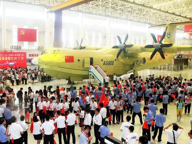 This picture taken on Saturday shows a crowd at a ceremony to unveil the AG600 amphibious plane in Zhuhai, in south China's Guangdong Province.