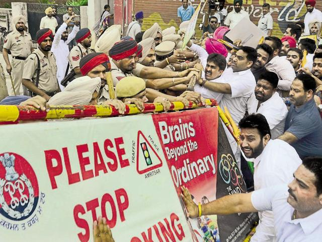 Youth Congress workers clashing with the police when they were being prevented from entering the office of local bodies minister Anil Joshi at Maqbool Road in Amritsar on Saturday.