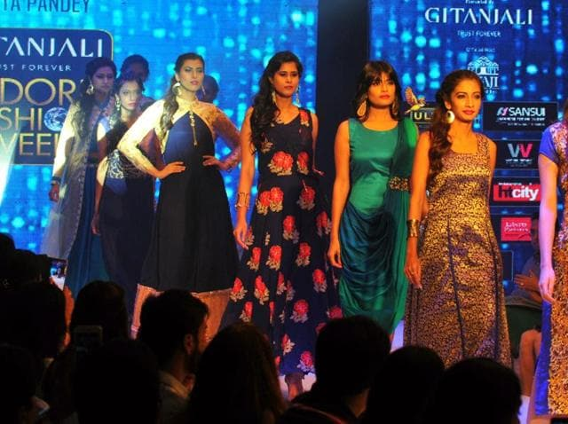 Models walk the ramp at the Indore fashion week on Saturday.