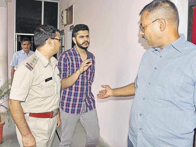 Uday Sharma (centre), was arrested by the Mansarovar police on Sunday.