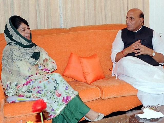 Home minister Rajnath Singh with Jammu and Kashmir chief minister Mehbooba Mufti during their meeting in Srinagar on Saturday.