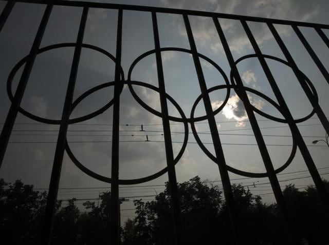 The Olympics rings are seen on a fence in front of the Russian Olympic Committee building in Moscow.