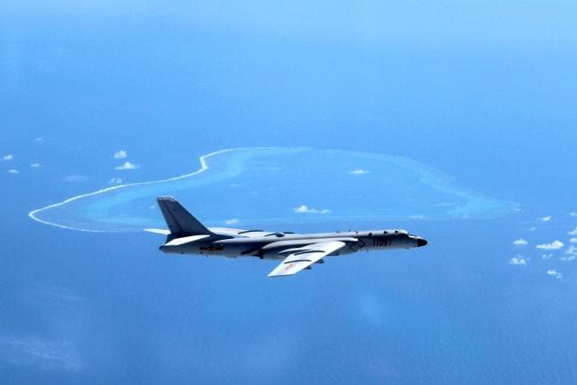 In this file photo released by Xinhua News Agency, a Chinese H-6K bomber is seen patrolling the islands and reefs in the South China Sea.