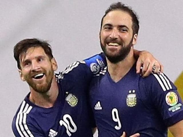 Gonzalo Higuain #9 of Argentina celebrates with Lionel Messi after scoring a goal.