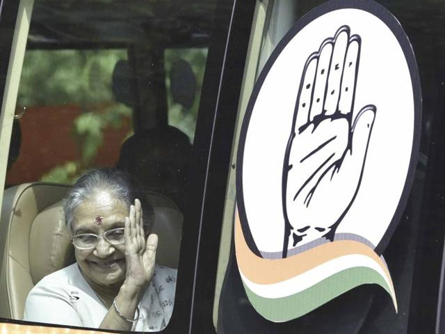 Congress' UP chief ministerial candidate Sheila Dikshit waves as the bus yatra is flagged off by Congress president Sonia Gandhi from the party office  on Saturday.