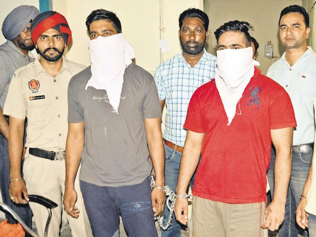 The murder accused in police custody in Amritsar on Sunday.