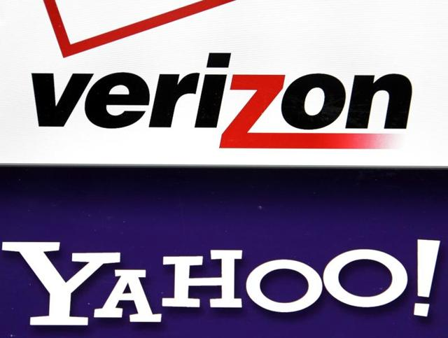 Logos are seen on a laptop in North Andover, Mass. Verizon is buying Yahoo for $4.83 billion, marking the end of an era for a company that once defined the internet.