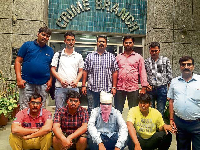 Amit Kumar (28), Vinod Kumar (30), Deepak (25) and Shekhar Jawla (27) (seated) allegedly opened a bogus company in the name of an already existing company — Aggarwal Packers and Movers Ltd — and copied their logo. The customers contacted them thinking they are dealing with the original firm.