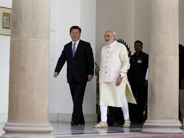 Prime Minister Narendra Modi with Chinese President Xi Jinping at the Hyderabad House in New Delhi.
