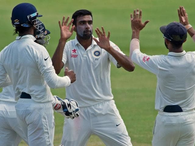 Indian cricketers celebrates with teammate Virat Kohli (2nd top L) during day four of the match.