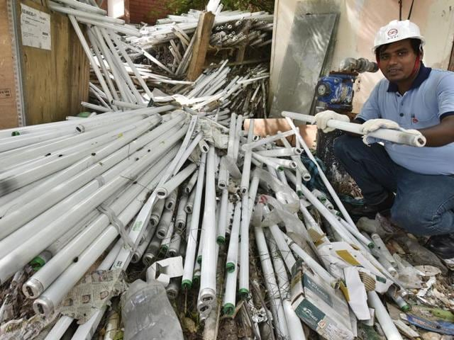 As there is no designated disposal site for hazardous waste in Delhi, 8489 CFL bulbs, 52,317 tubelights and 531 pieces of broken glass have been lying at the depot of Delhi Metro Rail Corporation near ISBT Shastri Park.(Raj K Raj/HT Photo)