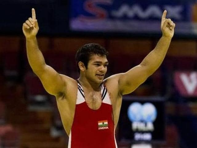 Narsingh Pancham Yadav celebrates after he won the men's 74kg freestyle weight class during the Vantaa Cup finals in Vantaa May 4, 2012.