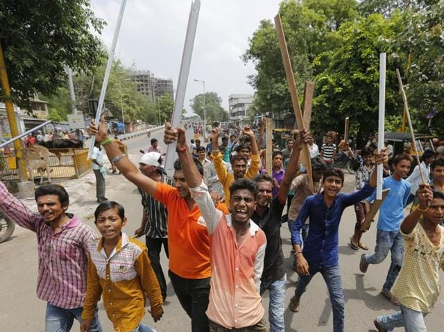 The Dalit youth's death in Surat comes amid protests over cow protection vigilantes thrashing four people from the community for skinning a dead cow in Gujarat.