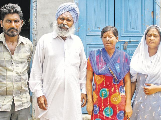 Victim Rajwant Kaur with her parents and Sandeep's father (right) at her house in Baba Jeevan Singh Nagar, Ludhiana.