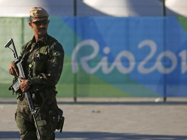 A special police forces officer stand guard outside the Olympic Park less than two weeks before the start of the Rio 2016 Olympic Games in Rio de Janeiro.