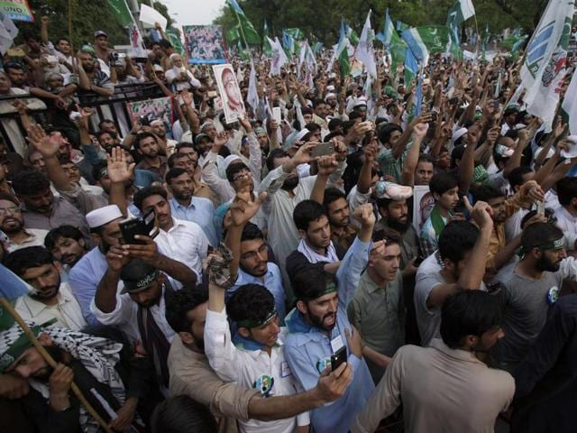Pakitani protesters chant slogans during an anti-Indian rally in Islamabad, Pakistan.