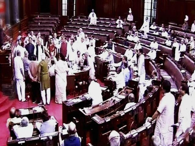 Opposition members protest in front of deputy chairman of Rajya Sabha PJ Kurien during the monsoon session of Parliament in New Delhi.