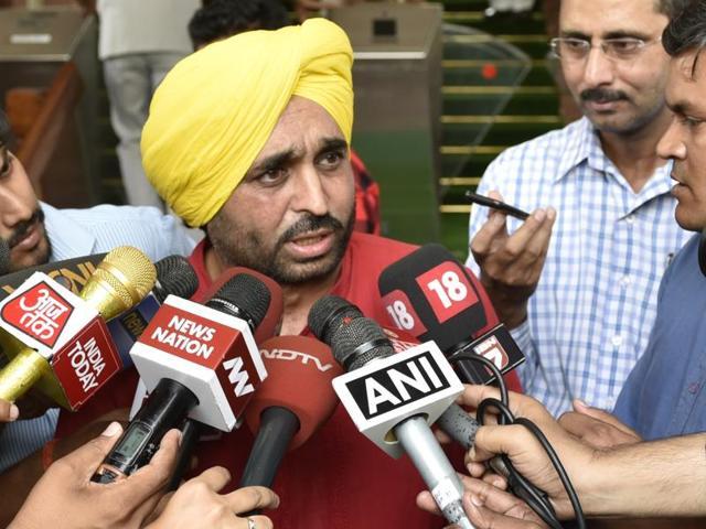 AAP MP Bhagwant Mann talks to media outside Parliament in New Delhi.