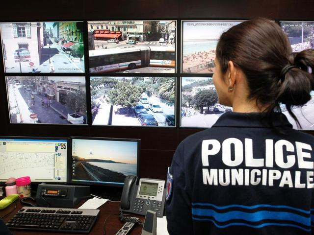 Afile photo of police officers and CSU operators working on a video projection system, in the Urban Supervisory Control Centre (CSU) in Nice.