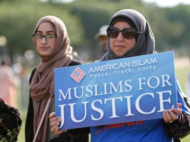 People take part in the Americans Against Terrorism, Hate and Violence rally on the National Mall in Washington, DC.