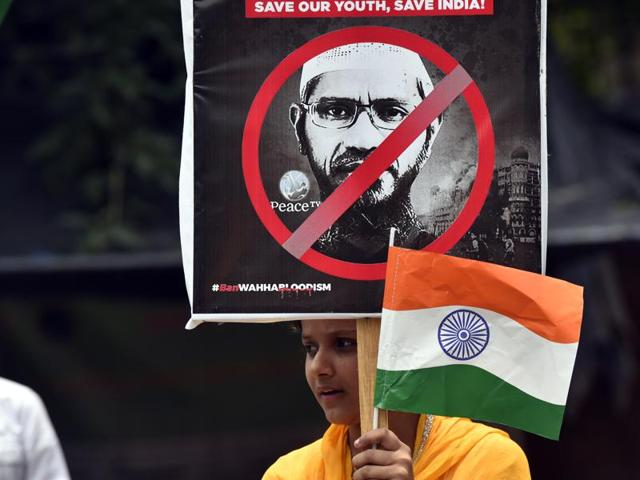 A girl protests against preacher Zakir Naik at Jantar Mantar in New Delhi.