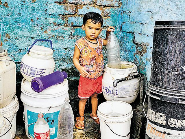 A boy standing beside a public tap at Colony Number 4 in Chandigarh on Monday. The Chandigarh MC pays Rs 1.60 crore maintenance charges and Rs 27 crore power bill every year to Punjab to get water from the Kajauli waterworks.