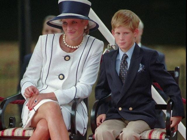 In this August 1995 file photo, Britain's Princess Diana, left, sits next to her younger son Prince Harry during V-J Day celebrations in London.