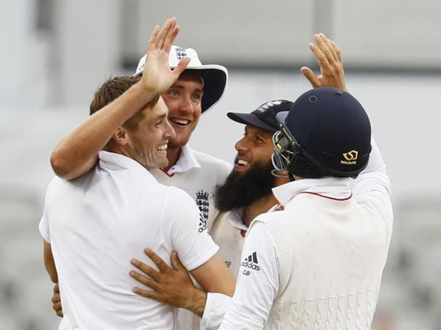 England's Chris Woakes celebrates taking the wicket of Pakistan's Mohammad Amir with teammates. He grabbed 3-41 to stretch his wicket tally to 18 in two test matches.