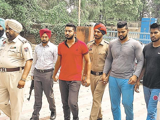The accused in police custody in SAS Nagar on Monday.