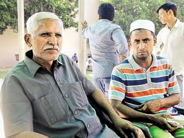 Greater Noida, India - October 01, 2015: (R-L) Afzaal Ahmad, a brother of Ikhlaq, Sartaz Ahmad, a son of Ikhlaq who was lynched in Bisada over cow slaughtering, in Greater Noida, India, on Thursday, October 01, 2015. (Photo by Sunil Ghosh / Hindustan Times)
