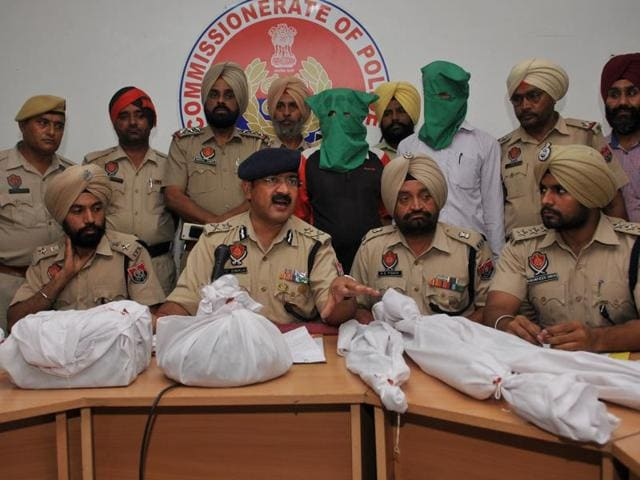 Police with the ammunition and two arrested men in Jalandhar on Tuesday.