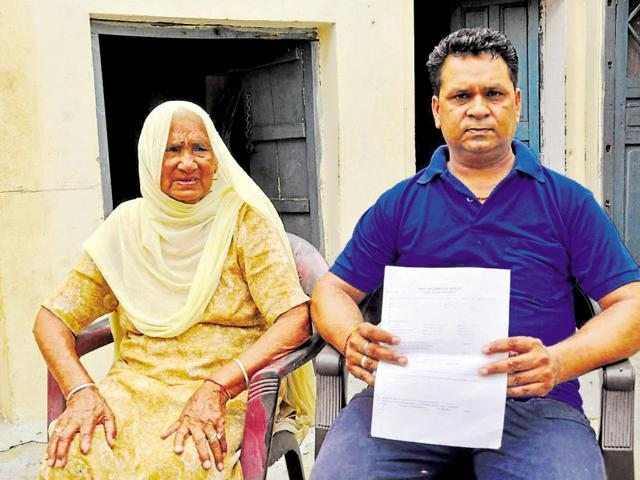 Gurmeet Pal, father of missing child Abhi, with his mother Ram Pyari in Jalandhar, on Monday.
