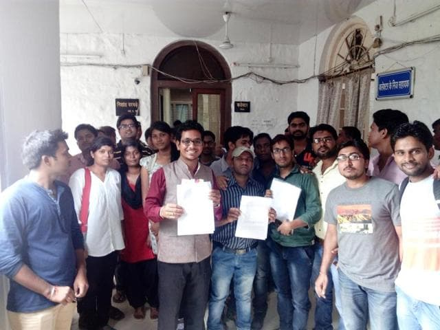 Maulana Azad National Institute of Technology SC and ST students protest against the administration for demanding tuition fees, in Bhopal on Monday.