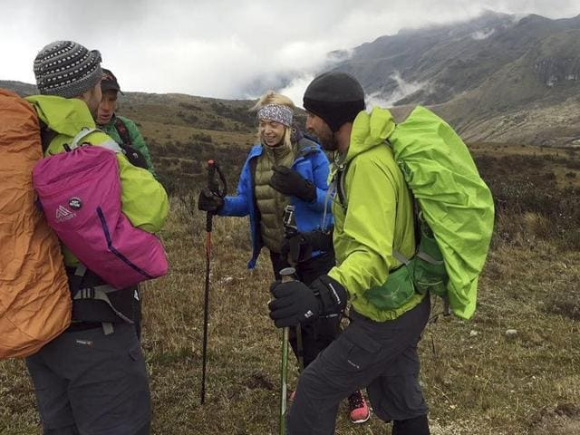 In this photo provided Monday, July 25, 2016 by the Range of Motion Project, Boston Marathon bombing survivor Adrianne Haslet, second from right, climbs Ecuador's Volcan Cayambe with a team of climbers and a guide.