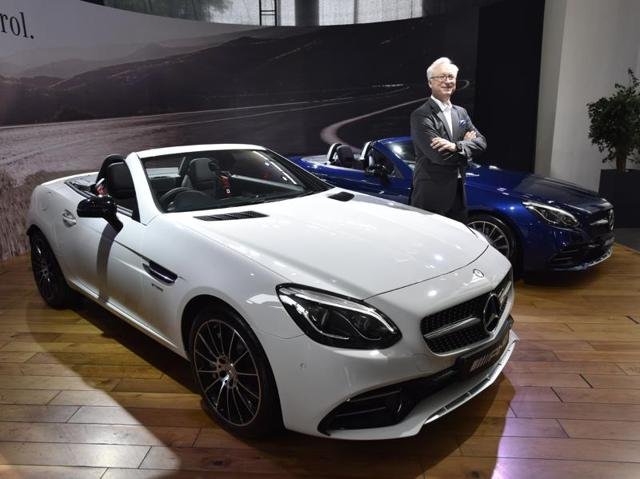 Roland S Folger, managing director & CEO of Mercedes-Benz India, poses with the Mercedes-AMG SLC43 during the car's launch in Delhi on Tuesday. The car has been priced at Rs 77.5 lakh. (Sanjeev Verma/ht photo)
