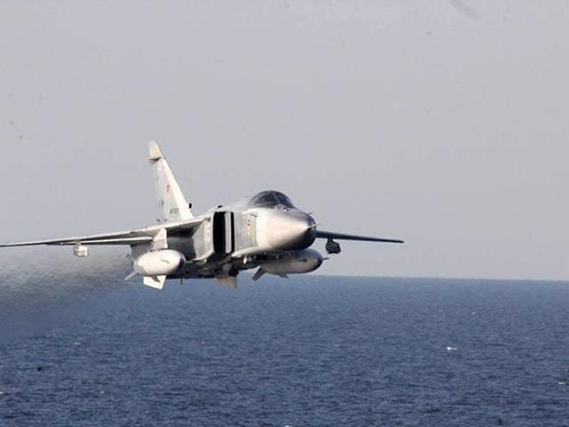 In this April 12, 2016 file photo provided by the US Navy, a Russian Sukhoi Su-24 attack aircraft makes a low altitude pass by the USS Donald Cook in the Baltic Sea.