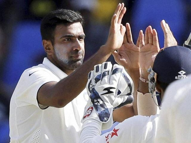 Ravichandran Ashwin is congratulated by teammates after dismissing West Indies' Devendra Bishoo.