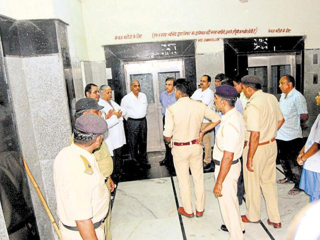 Police personnel inspecting the site near the lift at the Post Graduate Institute of Management Sciences where Anand Swaroop (inset) died on Monday.