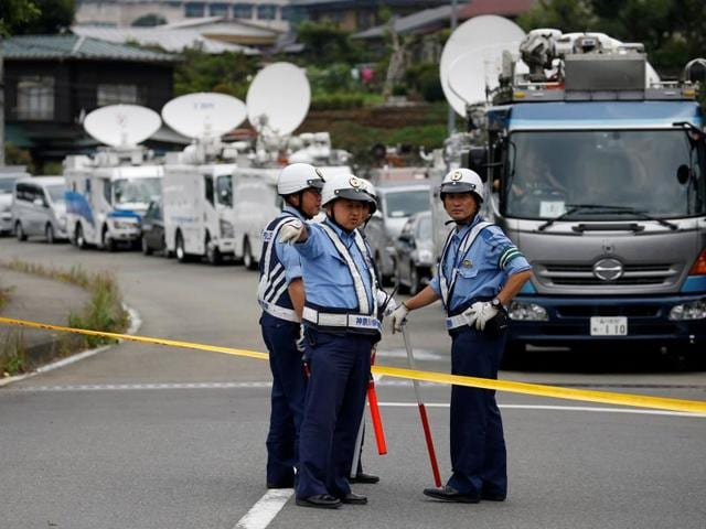 Police officers stand guard at a facility for the disabled, where a deadly attack by a knife-wielding man took place, in Sagamihara, Kanagawa prefecture, Japan, July 26, 2016.