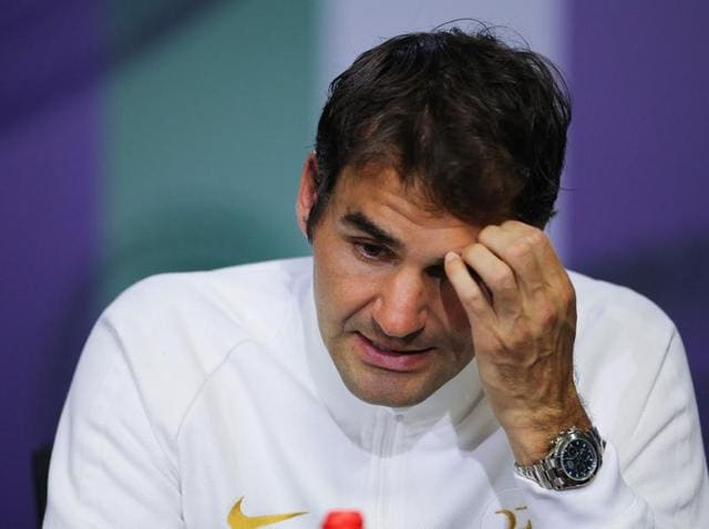 Switzerland's Roger Federer gives a press conference after being defeated by Canada's Milos Raonic in their men's singles semifinal match on the twelfth day of the 2016 Wimbledon Championships.