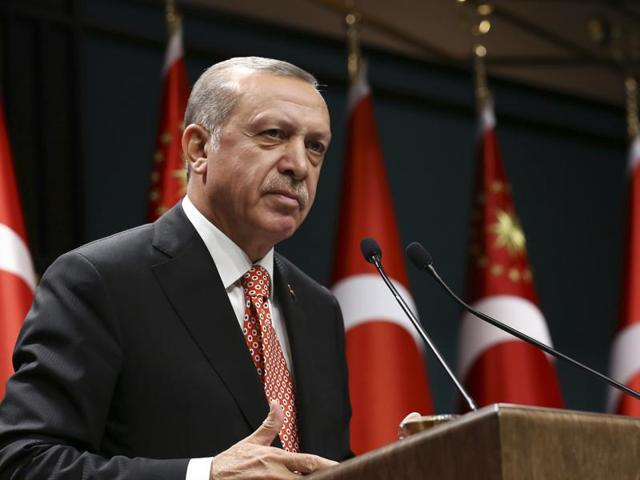 Turkey's President Recep Tayyip Erdogan, gestures during a televised address at the presidential palace in Ankara on Sunday/